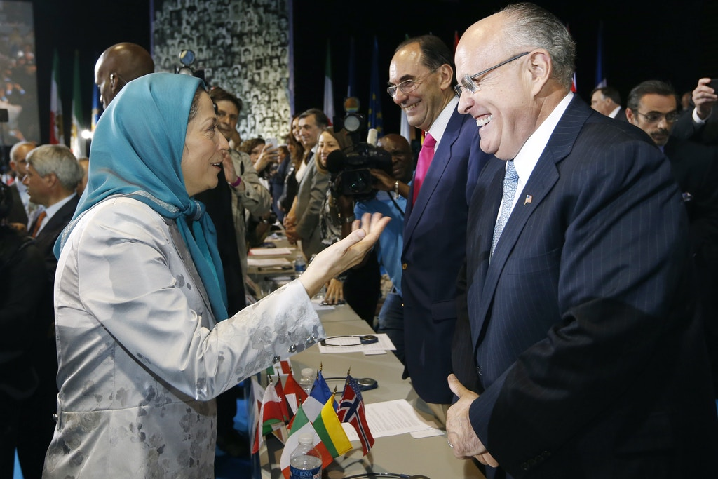 The president of the National Council of Resistance of Iran (NCRI), Maryam Rajavi (L) speaks with former New-York Mayor Rudy Giuliani (R) on June 23, 2012 in Villepinte, near Paris, during an international gathering asking for democracy in Iran.  AFP PHOTO/ THOMAS SAMSON