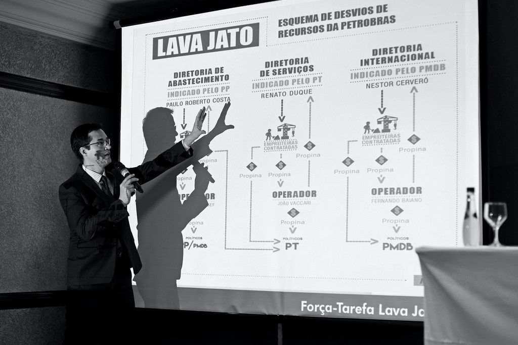 Brazil's Federal Public Ministry prosecutor, Deltan Martinazzo Dallagnol, speaks during a press conference about the Lava Jato operation on the Petrobras corruption scandal, in Curitiba on March 16, 2015. Brazilian police launched a new round of arrests Monday in the corruption scandal at state oil giant Petrobras, stating they had warrants for the arrest of 18 people in connection with the 10-year scheme of kickbacks and political payoffs that allegedly siphoned off $3.8 billion from the company. AFP PHOTO/HEULER ANDREY (Photo credit should read Heuler Andrey/AFP via Getty Images)