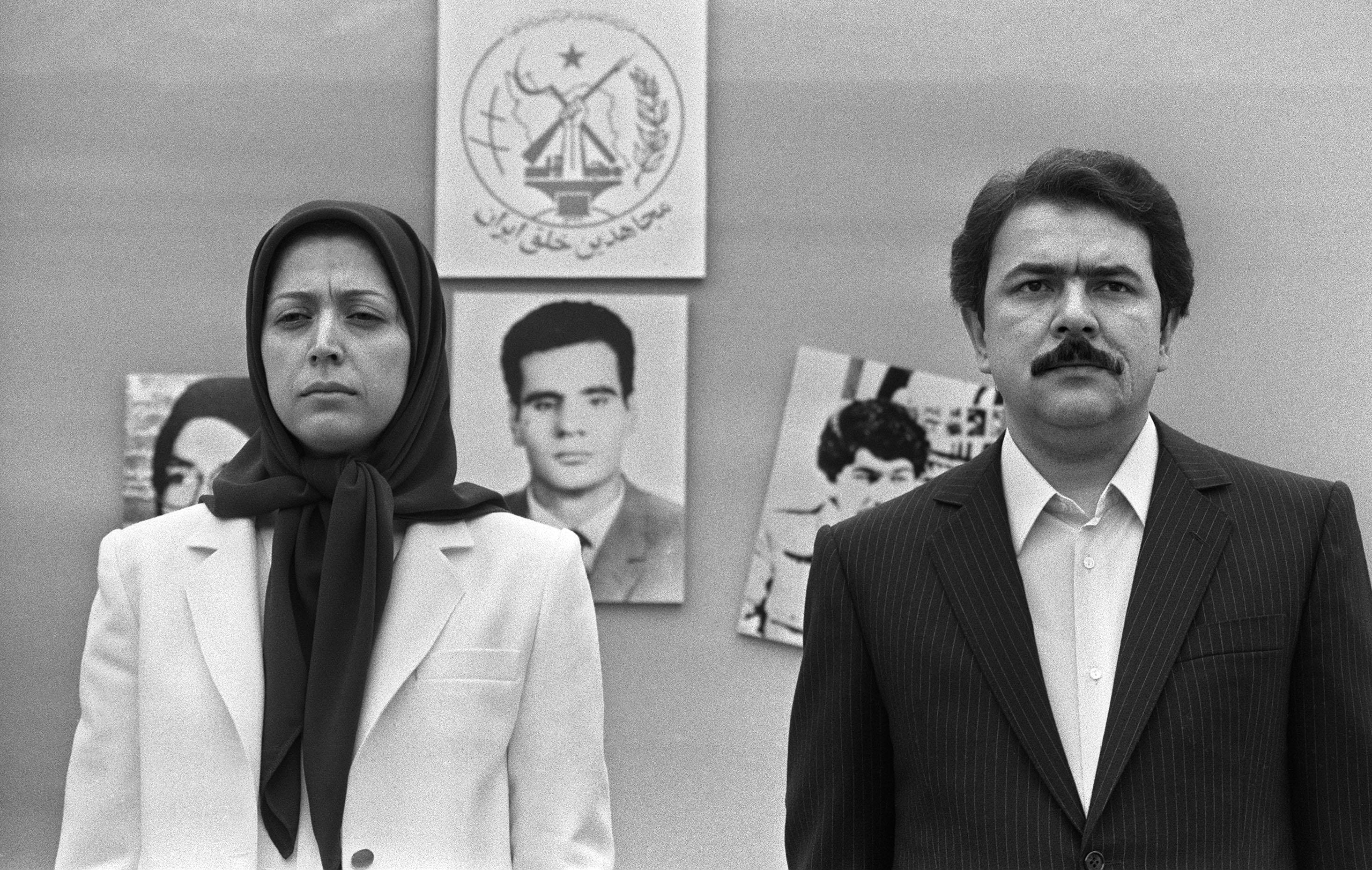 AUVERS-SUR-OISE, FRANCE:  Massoud Radjavi and his wife Maryam, leaders of the MEK, review militants celebrating their wedding 19 June 1985 at the headquarters of the National Council of Resistance of Iran (NCRI), the MEK's political front, at Auvers-sur-Oise, a northwestern suburb of Paris. Maryam Radjavi, arrested at the seat of NCRI in a massive crackdown by French police 17 June 2003 on her MEK organization, joined with her husband Massoud to turn Iran's main opposition group into a powerful military and political movement dominated by Marxism, Islam and Rajavi's personality cult.  AFP PHOTO DOMINIQUE FAGET