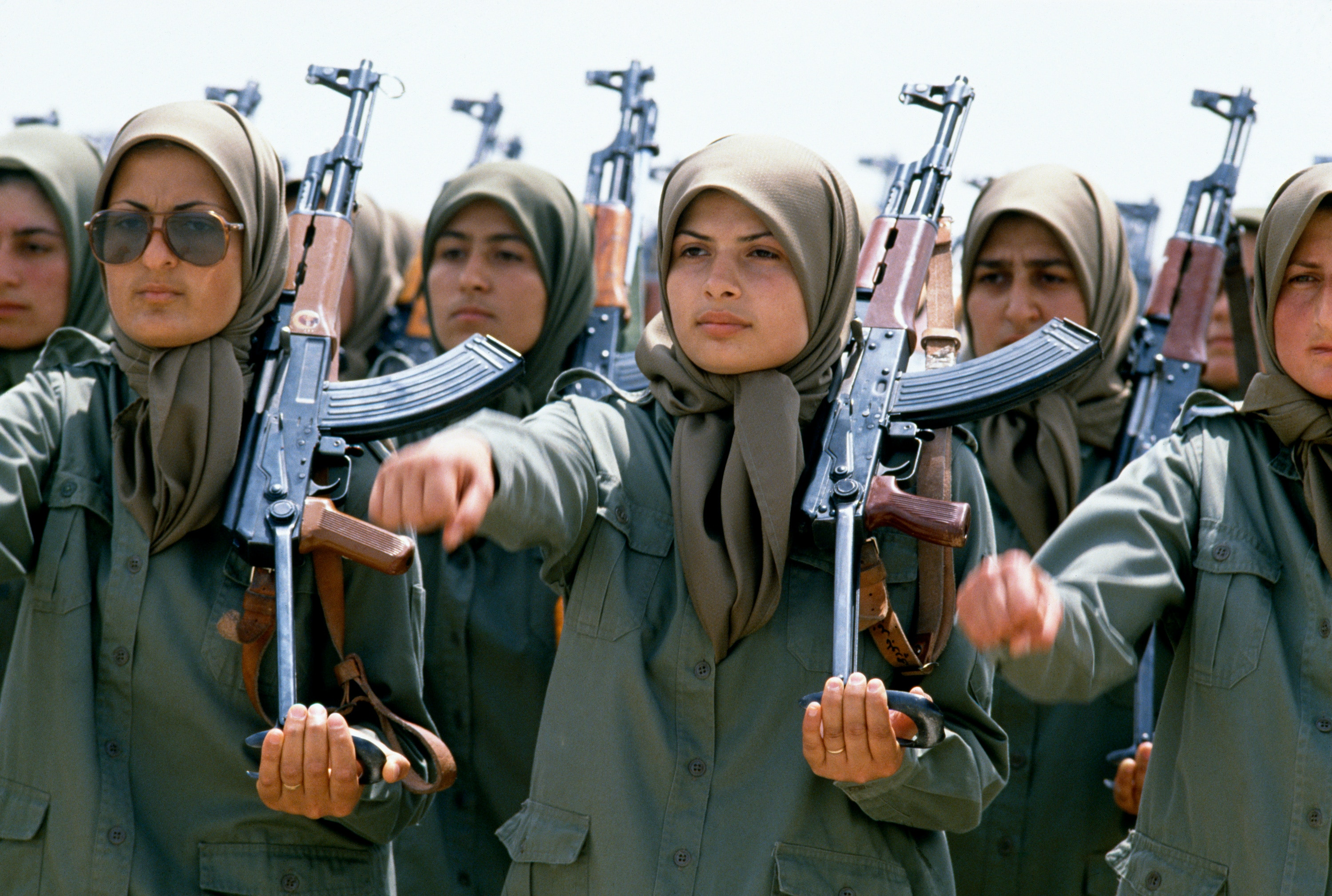 Female soldiers of the NLA (National Liberation Army of Iran) stand in formation holding AK-47s at a training camp east of Baghdad, Iraq. Women make up nearly half of the NLA, the armed wing of the Mujahideen Khalq Organization, an Iranian dissident group.