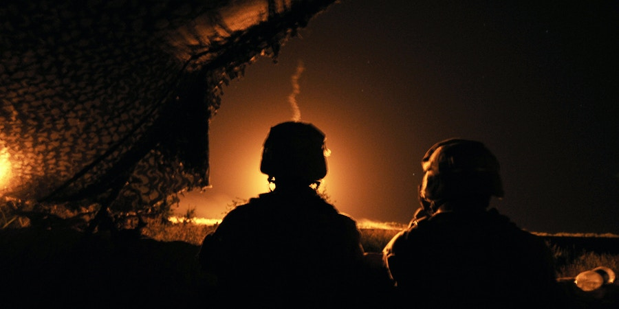 US Marines from C company 1/6 24 MEU stand alert as colleagues open fire on a Taliban target in Garmser in south of Helmand Province on May 5, 2008.   Helmand, the main source of Afghanistan's opium output, is in the grip of a Taliban-insurgency launched after it was toppled from government in a US-led invasion in late 2001. Most ISAF soldiers in Helmand are British, and were joined by US Marines last week in a push to remove the Taliban from around southern Garmser district.         AFP PHOTO/Massoud HOSSAINI (Photo credit should read MASSOUD HOSSAINI/AFP via Getty Images)