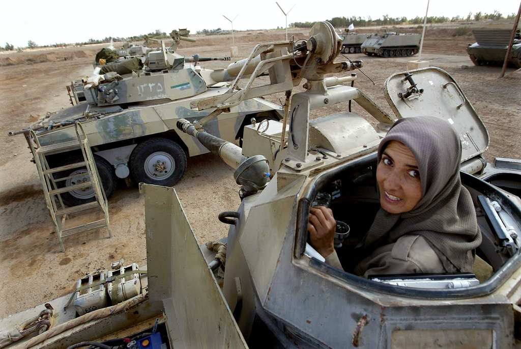 (NYT33) AL-ASHRAF CAMP, Iraq -- April 28, 2003 -- IRAQ-IRAN-REBELS-7 --Marieh Khoreshi, 42, a commander with an armored unit of the People's Mujahedeen of Iran, in her Brazilian-made Cascavel armored vehicle at the group's military camp in Al-Ashraf, north of Baghdad, Monday, April 28, 2003.  Despite being on the U.S. list of terrorist organizations, American military officials signed a ceasefire with the People's Mujahedeen, the largest and most active Iranian guerrilla group working for the overthrow of the Islamic government of Iran, on April 15. (Ruth Fremson/The New York Times)   *LITE