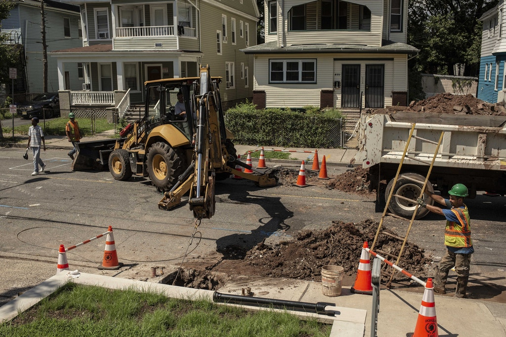Workers remove lead water pipes on South 17th St., in Newark, N.J., on Thursday, August 22, 2019.