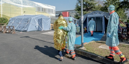 Tents outside a hospital in Brescia, Italy, are setup to provide testing for the coronavirus on Monday, March 16, 2020. (Alessandro Grassani/The New York Times)