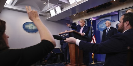 Reporters raise their hands to ask questions as President Donald Trump speaks about the coronavirus in the James Brady Press Briefing Room of the White House, Wednesday, April 1, 2020, in Washington. (AP Photo/Alex Brandon)