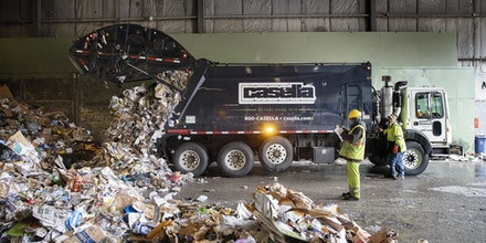 PORTLAND, ME - APRIL 10: A truck empties its load of recycling at ecomaine on Friday, April 10, 2020. (Staff photo by Derek Davis/Portland Press Herald via Getty Images)