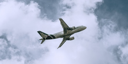 A passenger aircraft, operated by Alitalia-Societa Aerea Italiana SpA, takes off from Linate airport in Milan, Italy, on Wednesday, Feb. 26, 2020. As the number of people infected by the coronavirus in Italy rises above 300 -- mostly in the rich, industrial north -- restrictions imposed to stem its spread are threatening deeper economic woes. Photographer: Gianmarco Maraviglia/Bloomberg via Getty Images