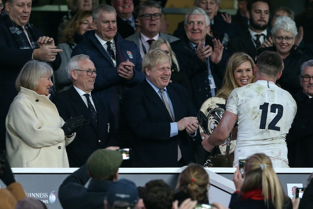 LONDON, ENGLAND - MARCH 07: Prime Minister Boris Johnson congratulates England captain Owen Farrell on the Triple Crown during the 2020 Guinness Six Nations match between England and Wales at Twickenham Stadium on March 7, 2020 in London, England. (Photo by Charlotte Wilson/Offside/Offside via Getty Images)