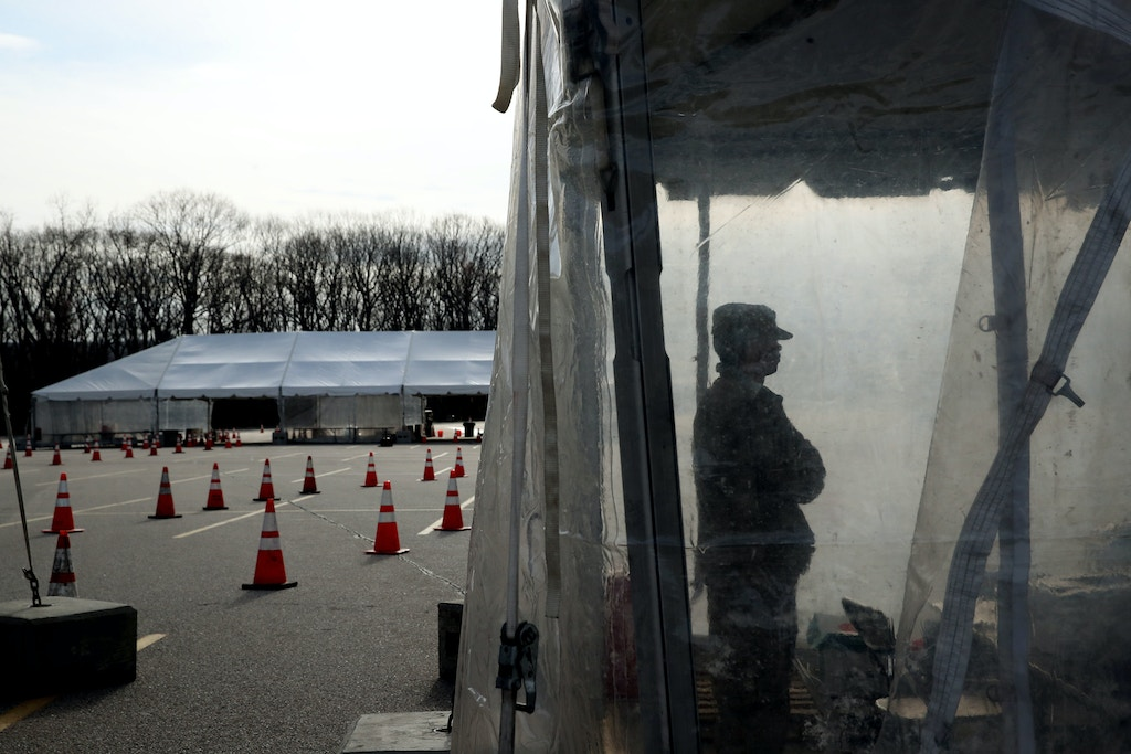 WARWICK, RI - APRIL 1: Members of the Rhode Island Army National Guard prepare to process patients at the sample collection site at the Community College of Rhode Island's Knight Campus in  Warwick, RI on April 1, 2020. The site is part of the Rhode Island Army National Guard's Joint Task Force Guardian that operates 3 remotes coronavirus test sites. The sites can perform 300 tests per day each with a capacity to double that number. (Photo by Craig F. Walker/The Boston Globe via Getty Images)