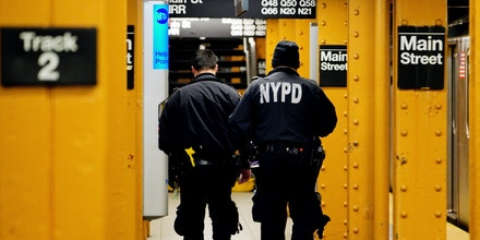 NYPD officers patrol the 7 train subway station in Flushing, Queens, New York, on April 5, 2020.