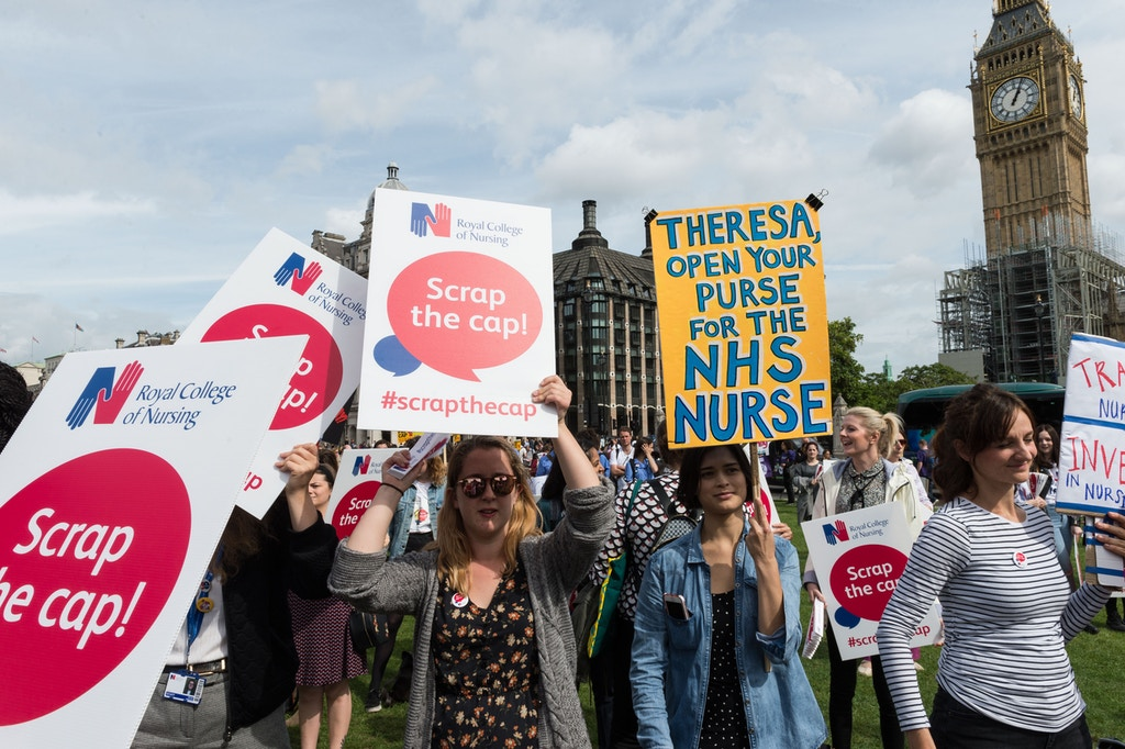 LONDON, UNITED KINGDOM - SEPTEMBER 06: Thousands of nurses attend a Royal College of Nursing (RCN) rally in Parliament Square to protest against the pay restraint and urge the Government to scrap the 1% pay cap on nursing pay on September 06, 2017 in London, England. PHOTOGRAPH BY Wiktor Szymanowicz / Barcroft Images London-T:+44 207 033 1031 E:hello@barcroftmedia.com - New York-T:+1 212 796 2458 E:hello@barcroftusa.com - New Delhi-T:+91 11 4053 2429 E:hello@barcroftindia.com www.barcroftimages.com (Photo credit should read Wiktor Szymanowicz / Barcroft Media via Getty Images / Barcroft Media via Getty Images)