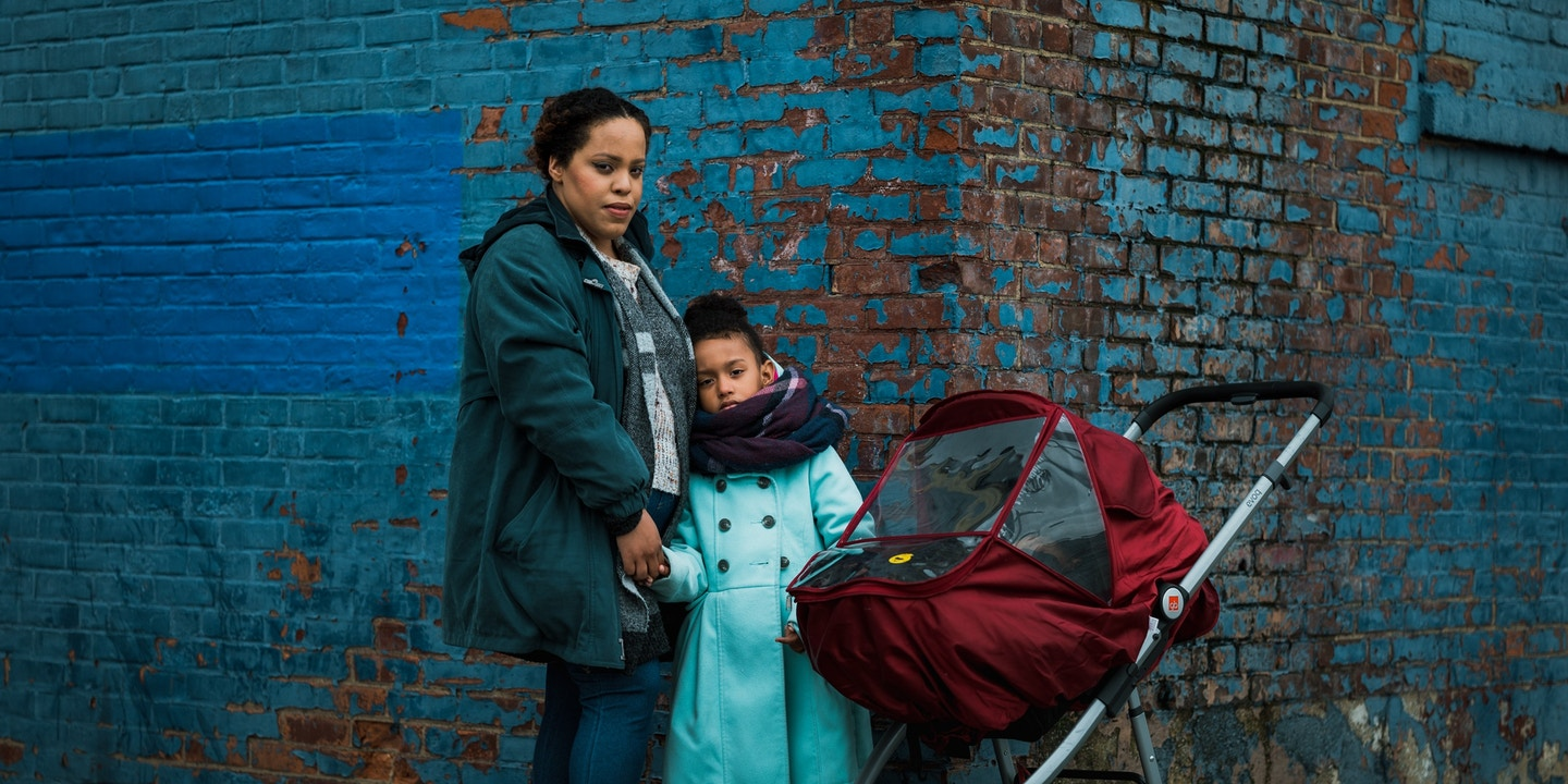 Johanna Garcia, 27, left, her daughter, Abigail, 4, center, and son Logan, 10 months, right, pose for a portrait during their daily walk through the South Bronx. Ms. Garcia and her children live in a homeless shelter in the Bronx, where she says the close living quarters with others make the COVID-19 pandemic especially worrisome for people living in city shelters.