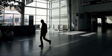 A man walks through an empty San Francisco International Airport in San Francisco, Calif., on Tuesday, April 7, 2020. Air traffic was practically at a standstill due to the coronavirus pandemic. (Jane Tyska/Digital First Media/East Bay Times via Getty Images)