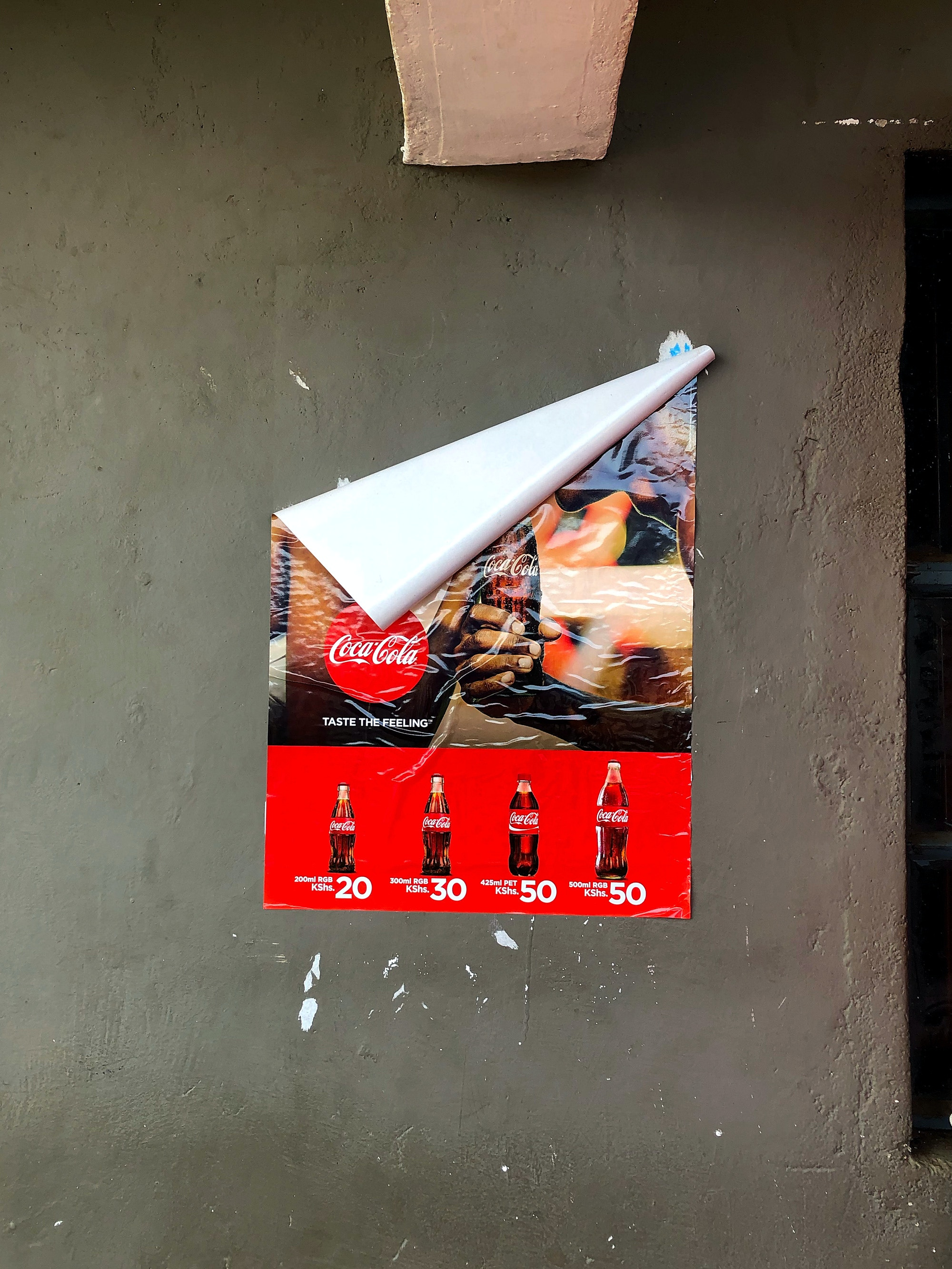 A Coca-Cola ad on the wall of a restaurant in Northern Kenya.