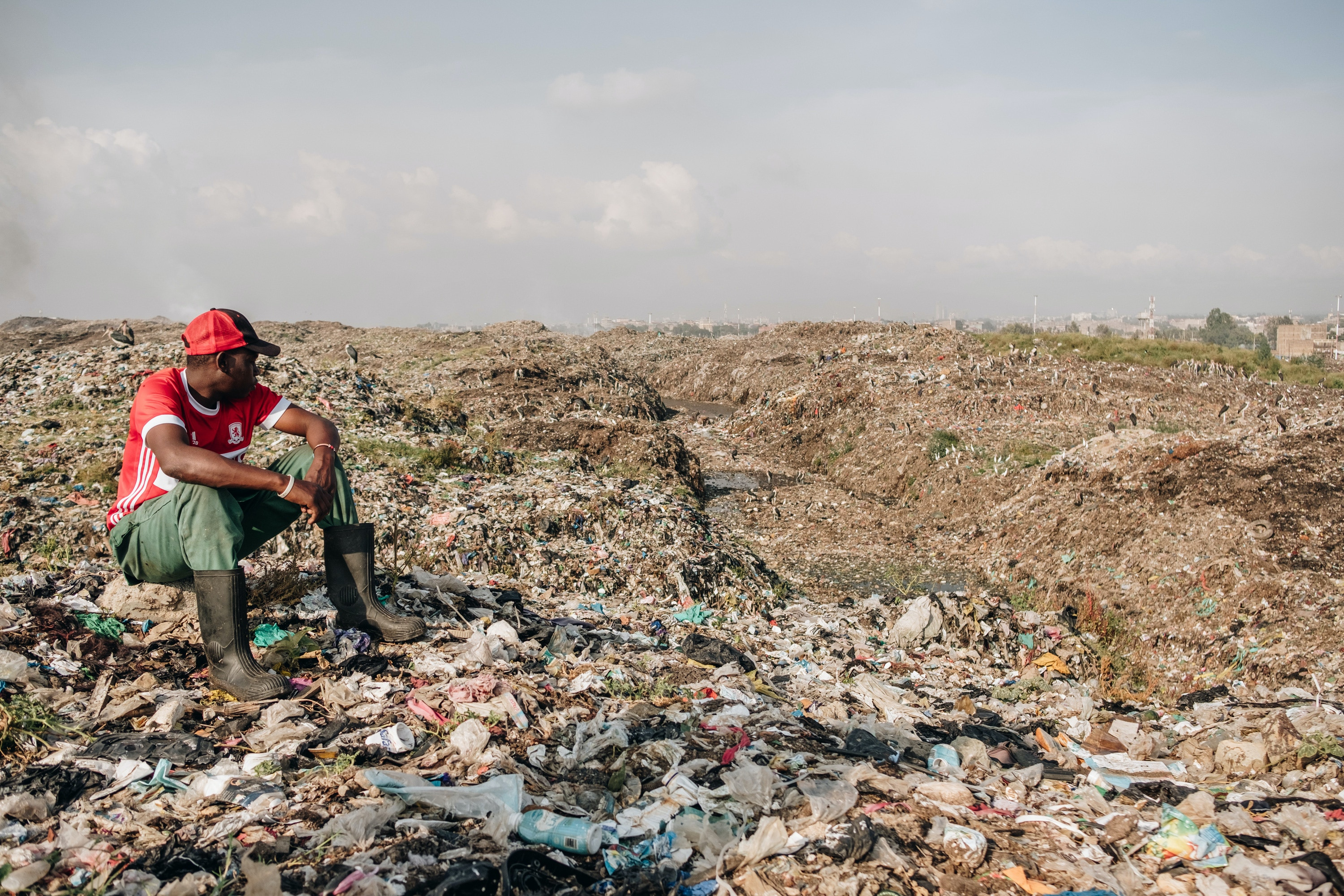 "Mwangi Mboya overlooks the hills of Dandora Municiple Dump Site in Nairobi, Kenya. ""I grew up here. These people are my family."" Feb. 29, 2020. (Khadija Farah for The Intercept)."