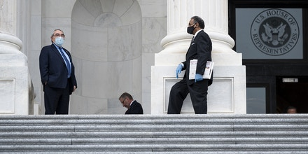 UNITED STATES - APRIL 23: Rep. G.K. Butterfield, D-N.C., left, and Rep. Emanuel Cleaver, D-Mo., wear a face masks as they talk on the House steps of the U.S. Capitol before the House vote on the $483.4 billion economic relief package on Thursday, April 23, 2020.(Photo By Bill Clark/CQ-Roll Call, Inc via Getty Images)