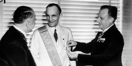 FILE- German diplomats award Henry Ford,center, Nazi Germany's highest decoration for foreigners, The Grand Cross of the German Eagle,in Detroit on July, 30,  1938 for his  service  to the Third Reich. Karl Kapp, German consul in Cleveland pins the medal while Fritz Heiler, left, German consul in Detroit shakes his hand. General Motors Corp. and Ford Motor Co. deny helping the Nazis during World War II and profiting from forced labor at their German subsidiaries.     The Washington Post reported Monday, Nov.30,1998, that lawyers and historians were compiling evidence of collaboration for possible use in class-action lawsuits on behalf of former prisoners of war.(AP Photo/file)