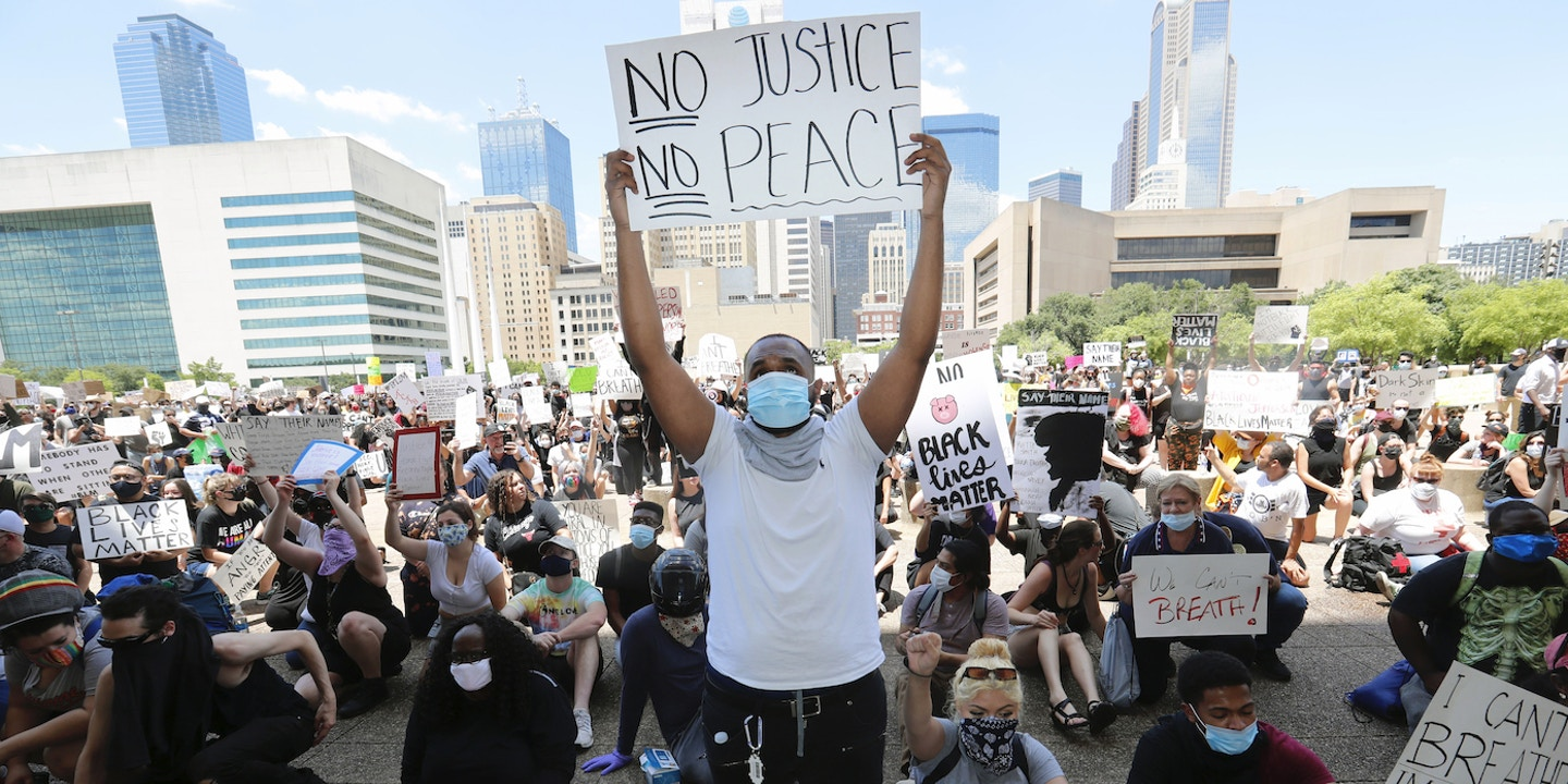 Protesters demonstrate police brutality in front of Dallas City Hall in downtown Dallas, Saturday, May 30, 2020. Protests across the country have escalated over the death of George Floyd who died after being restrained by Minneapolis police officers on Memorial Day. (AP Photo/LM Otero)