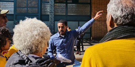 Andom Ghebreghiorgis speaks with volunteers at an event in the Bronx on March 7, 2020 in New York.