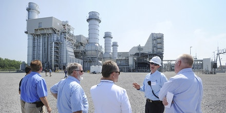 Neil Newman, PCC Systems Engineer for Tennessee Valley Authority, second from right, gives a tour of the new Paradise Combined Cycle Gas Plant, Wednesday, July 12, 2017, in Drakesboro, Ky. The plant uses natural gas and steam to generate up to 1,100 megawatts of electricity daily,  enough to power more than 500,000 homes. (Alan Warren/The Messenger-Inquirer via AP)