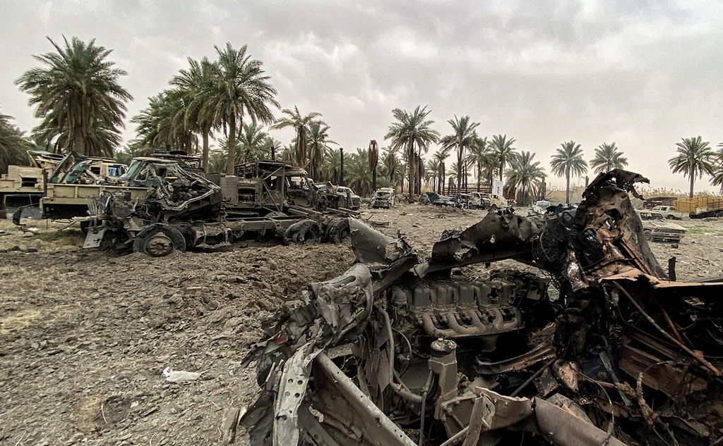 This picture taken on March 13, 2020 shows damaged military vehicles in the aftermath of US military air strikes at a militarised zone in the Jurf al-Sakhr area in Iraq's Babylon province (south of the capital) controlled by Kataeb Hezbollah, a hardline faction of the Hashed al-Shaabi (Popular Mobilisation) forces paramilitaries. - US air strikes targeting pro-Iranian military factions in Iraq killed one civilian and five security personnel early on March 13, the Iraqi military said, warning the raids risked a bloody escalation for the war-battered country. The Pentagon said the strikes were in retaliation for rocket fire against an Iraqi base the night of March 12 that killed one British and two US military personnel in the deadliest such attack in years. (Photo by - / AFP) (Photo by -/AFP via Getty Images)