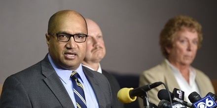 Albany County District Attorney David Soares, left, addresses the media during a news conference Thursday morning, Oct. 9, 2014, at Town Hall in Guilderland, N.Y., about four people  found slain in a home in the Albany suburb. (AP Photo/The Albany Times Union, Skip Dickstein)  TROY, SCHENECTADY; SARATOGA SPRINGS; ALBANY OUT