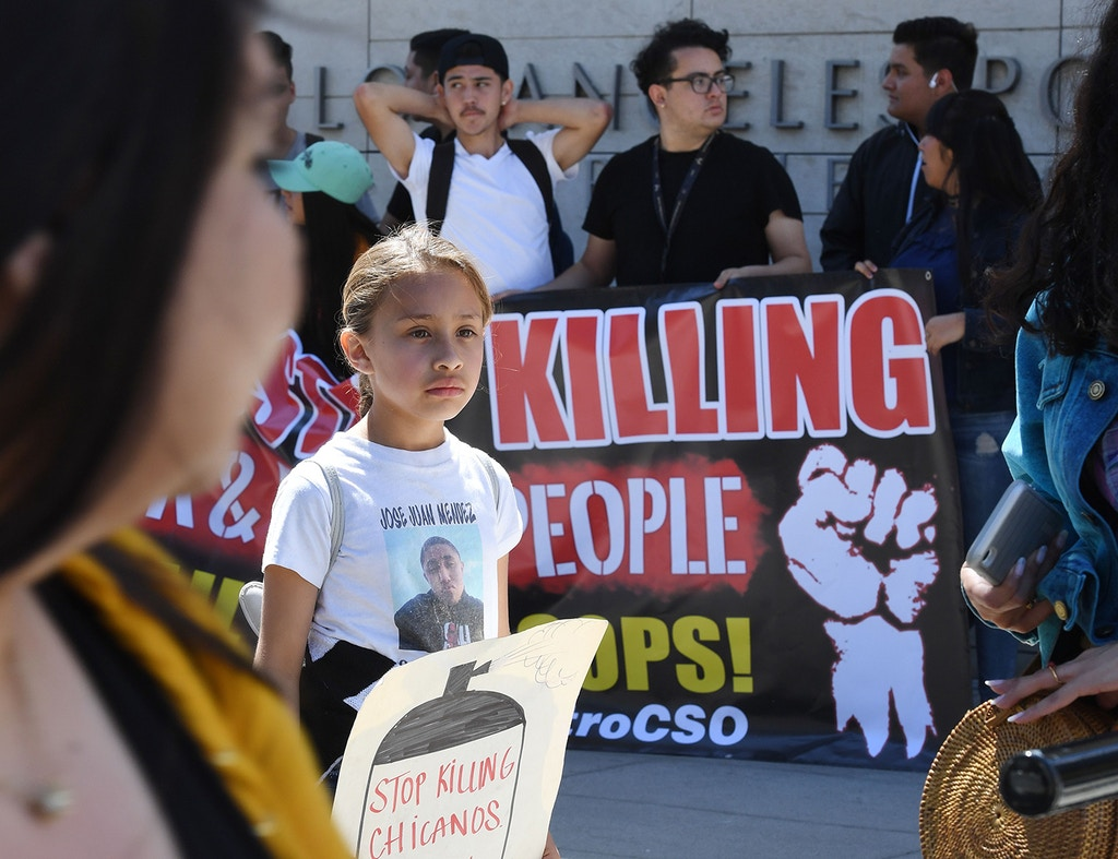 Nine year old Jennifer Mendez, who said her brother Jose Mendez was shot and killed by police, joins human rights protesters as they demonstrate against police killings, outside police headquarters in Los Angeles on March 30, 2019. (Photo by Mark RALSTON / AFP)        (Photo credit should read MARK RALSTON/AFP via Getty Images)