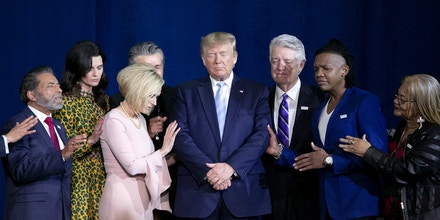 FILE: U.S. President Donald Trump, center, prays during an 'Evangelicals for Trump' Coalition launch event in Miami, Florida, U.S., on Friday, Jan. 3, 2020. Monday, January 20, 2020, marks the third anniversary of U.S. President Donald Trump's inauguration. Our editors select the best archive images looking back over Trumps term in office. Photographer: Marco Bello/Bloomberg via Getty Images