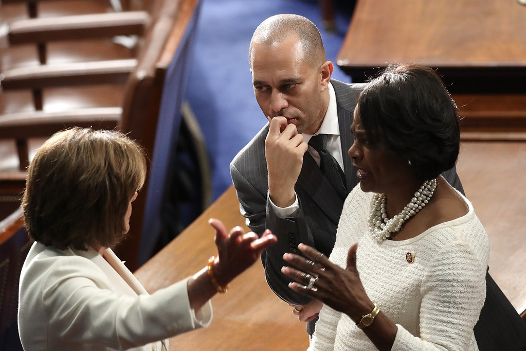 WASHINGTON, DC - FEBRUARY 04: House Speaker Rep. Nancy Pelosi (D-CA)  (L) speaks with Rep. Val Demings (D-FL) and Hakeem Jeffries (D-NY) after the State of the Union address in the chamber of the U.S. House of Representatives on February 04, 2020 in Washington, DC.  President Trump delivers his third State of the Union to the nation the night before the U.S. Senate is set to vote in his impeachment trial.  (Photo by Drew Angerer/Getty Images)