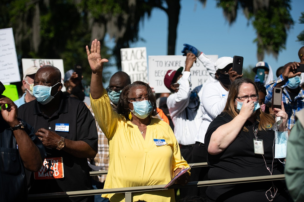 BRUNSWICK, GA - MAY 08: Demonstrators protest the shooting death of Ahmaud Arbery at the Glynn County Courthouse on May 8, 2020 in Brunswick, Georgia. Gregory McMichael and Travis McMichael were arrested the previous night and charged with the murder of Arbery. (Photo by Sean Rayford/Getty Images)