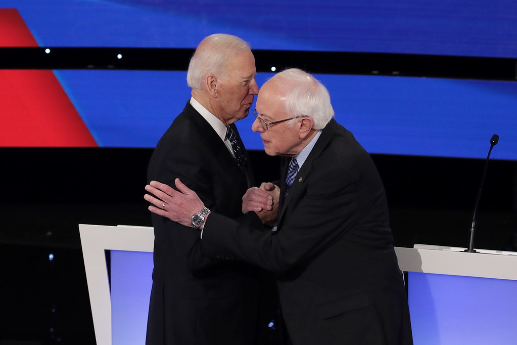DES MOINES, IOWA - JANUARY 14:  Former Vice President Joe Biden (L) greets Sen. Bernie Sanders (I-VT) before the Democratic presidential primary debate at Drake University on January 14, 2020 in Des Moines, Iowa.  Six candidates out of the field qualified for the first Democratic presidential primary debate of 2020, hosted by CNN and the Des Moines Register.  (Photo by Scott Olson/Getty Images)