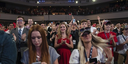 Supporters of President Donald Trump cheer as he arrives to a group of young Republicans at Dream City Church, Tuesday, June 23, 2020, in Phoenix. (AP Photo/Evan Vucci)