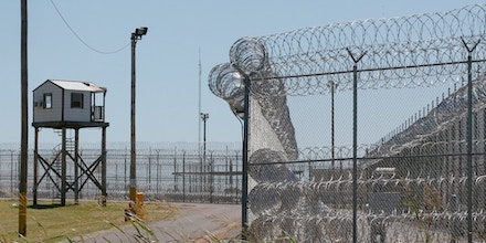 FILE - This July 10, 2017, file photo shows a tower outside of the razor wire at the Great Plains Correctional Facility in Hinton, Okla. Prisons in Oklahoma are locked down after several inmate fights over the weekend caused one inmate death and more than a dozen injuries. (AP Photo/Sue Ogrocki, File)