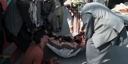 Afghan villagers carry the body of a civilian during a protest in the city of Ghazni, west of Kabul, Afghanistan, Sunday, Sept. 29, 2019. An airstrike by U.S.-led forces overnight in eastern Afghanistan killed at least five civilians, local villagers said Sunday. Ahmad Khan Serat, spokesman for Ghazni province's police chief, said dozens of people marched from the Khoja Omari district to bring the five bodies to local authorities in the regional capital. (AP Photo/Rahmatullah Nikzad)