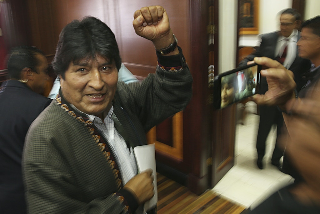 In this Nov. 27, 2019 photo, Bolivia's former President Evo Morales pumps his fist after a press conference at the journalists club in Mexico City. Morales went into exile in Mexico after he was prodded by police and the military, forcing him to resigned on Nov. 10, after he claimed victory in an election that international observers invited in by the government said was marred by numerous irregularities. (AP Photo/Marco Ugarte)