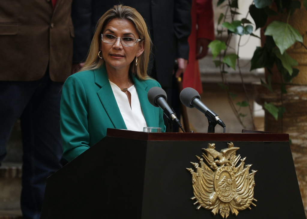 "Bolivia's interim President Jeanine Anez addresses the nation at the presidential palace in La Paz, Bolivia, Wednesday, Jan. 22, 2020. The message marked the anniversary of the naming of Bolivia as the ""Plurinational State of Bolivia,"" by former President Evo Morales. (AP Photo/Juan Karita)"