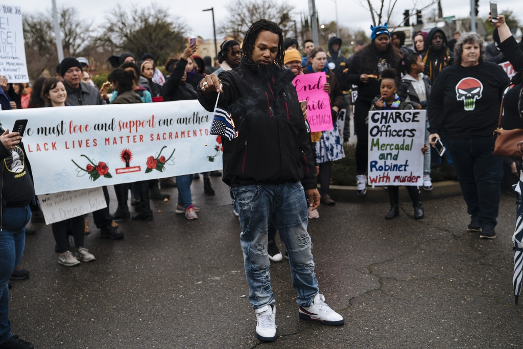SACRAMENTO, CA - MARCH 02: Demonstrators burned Thin Blue Line flags outside Sacramento Police Department on March 2, 2019, in Sacramento, California. Sacramento County District Attorney Anne Marie Schubert announced Saturday that officers did not break any laws when they shot Stephon Clark in 2018. (Photo by Mason Trinca/Getty Images)