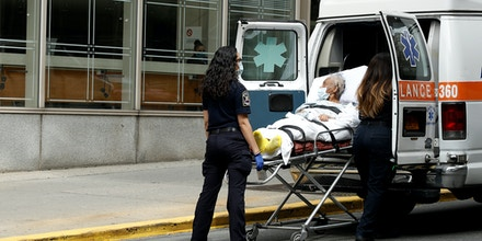 EMT staff move a patient into an ambulance in front of Mt. Sinai Morningside Hospital  on May 18, 2020 in New York City. COVID-19 has spread to most countries around the world, claiming over 320,000 lives and infecting almost 4.9 million people. (Photo by John Lamparski/NurPhoto via Getty Images)