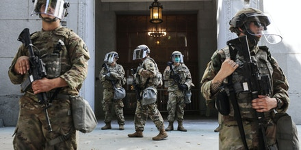 LOS ANGELES, CALIFORNIA - JUNE 03: National Guard troops are posted outside the District Attorney's office during a peaceful demonstration over George Floyd's death on June 3, 2020 in Los Angeles, California. California Governor Gavin Newsom deployed National Guard troops to Los Angeles County following unrest which occurred amid some demonstrations. Former Minneapolis police officer Derek Chauvin was taken into custody for Floyd's death and is now charged with second-degree murder while three other former officers have been charged with aiding and abetting second-degree murder. (Photo by Mario Tama/Getty Images)
