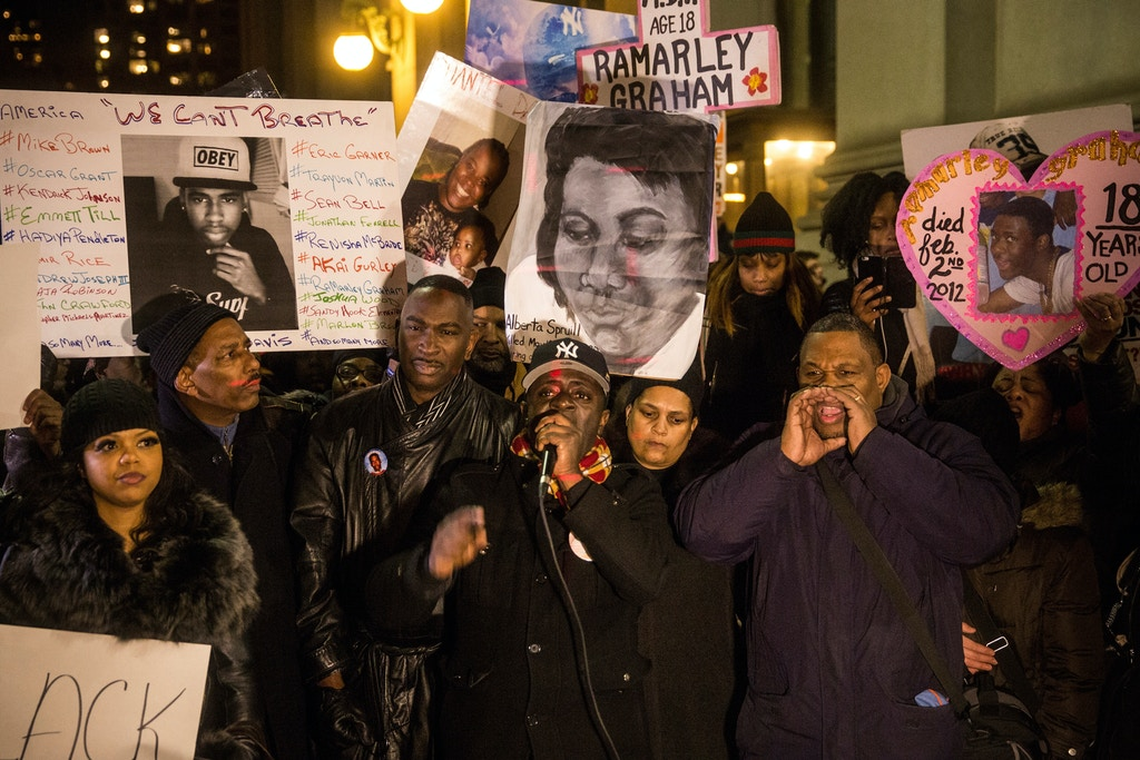 NEW YORK, NY - DECEMBER 13:  Frank Graham (C), father of Ramarley Gragam, who was shot and killed by police officers in New York in 2012, speaks outside the New York Police Department Headquarters after marching in the National March Against Police Violence, which was organized by National Action Network, on December 13, 2014 in New York City. The march coincided with a march in Washington D.C. and comes on the heels of two grand jury decisions not to indict white police officers in the deaths of two unarmed black men.  (Photo by Andrew Burton/Getty Images)