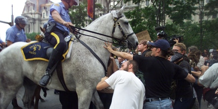 Protestors try to hold back advancing police horses during the 2000 Republican National Convention in Philadelphia on Aug. 1, 2000.