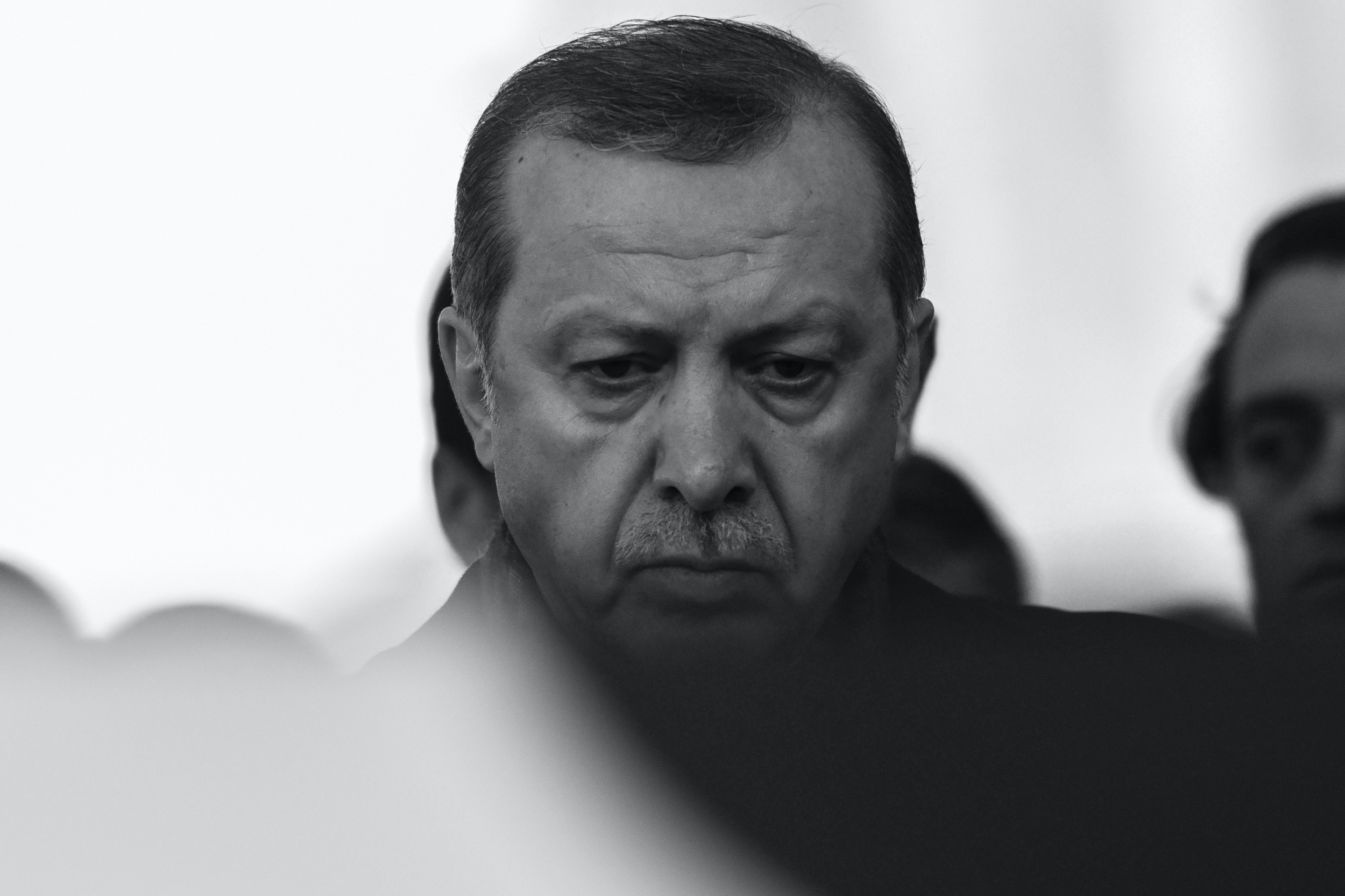 Turkish President Recep Tayyip Erdogan attends the funeral of Turkish police officer Hasim Usta, who was killed in the December 10 blasts outside Besiktas' Vodafone Arena football stadium, on December 12, 2016 in Istanbul. The death toll from the Istanbul twin bombings near the major football stadium has risen to 44, Turkish Health Minister Recep Akdag said on December 12. / AFP / OZAN KOSE (Photo credit should read OZAN KOSE/AFP via Getty Images)