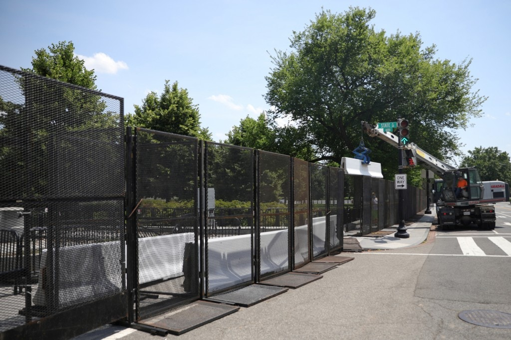 Concrete barricades are placed behind exterior fencing outside of the Eisenhower Executive Office Building at the White House, following a night of protests against the death in Minneapolis police custody of George Floyd, near the White House in Washington, U.S., June 4, 2020. REUTERS/Tom Brenner - RC2J2H9L6N6P