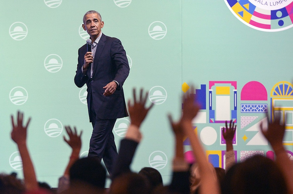 Former U.S. President Barack Obama speaks on the stage as he attends an Obama Foundation event in Kuala Lumpur, Malaysia, 13 December 2019. Obama and his wife Michelle are in Kuala Lumpur for the inaugural Leaders: Asia-Pacific conference, focused on promoting women's education in the region.  (Photo by Zahim Mohd/NurPhoto via Getty Images)