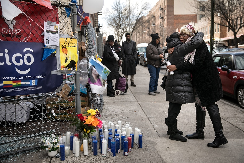 NEW YORK, NY - APRIL 5: Mourners embrace as they arrive before a rally in protest of the police-involved shooting death of Saheed Vassell, in the Crown Heights neighborhood of Brooklyn, April 5, 2018 in New York City. Saheed Vassell, 34, was killed by police officers on Wednesday afternoon in Crown Heights. He was unarmed but was reportedly acting erratic and wielding a curved silver pipe that witnesses thought could have been a gun. (Photo by Drew Angerer/Getty Images)