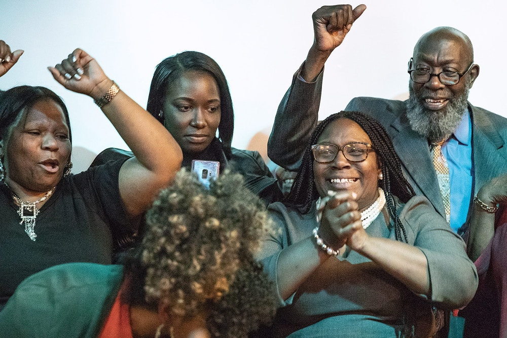 Kendra Brooks, right, gives a speech at her results watch party for the Working Families in North Philadelphia on Tuesday, Nov. 5, 2019. Kendra Brooks won a Philadelphia City Council seat in a historic win for the Working Families Party and Philly progressives.   (Heather Khalifa/The Philadelphia Inquirer via AP)