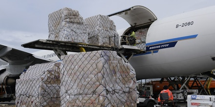 FILE - In this April 10, 2020, file photo, ground crew at the Los Angeles International airport unload pallets of supplies of medical personal protective equipment from a China Southern Cargo plane upon its arrival. An Associated Press review of more than 20 states found that before the coronavirus outbreak many had at least a modest supply of N95 masks, gowns, gloves and other medical equipment. But those supplies often were well past their expiration dates, left over from the H1N1 influenza outbreak a decade ago. (AP Photo/Richard Vogel, File)