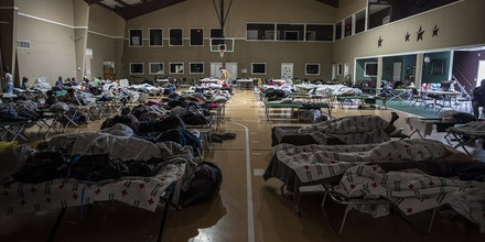 Cots are set offering temporary shelter at First Baptist Church following Tropical Storm Imelda in Hamshire, Texas, U.S., on Friday, Sept. 20, 2019. The remnants of Tropical Storm Imelda lashed Houston and coastal Texas, inundating homes, paralyzing travelers, disrupting oil supplies, and threatening hospitals and refineries. Photographer: Sergio Flores/Bloomberg via Getty Images