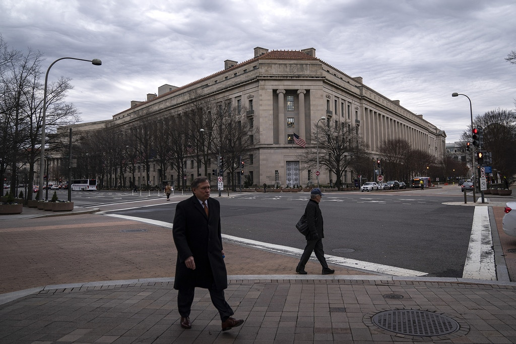 WASHINGTON, DC - FEBRUARY 19: The Department of Justice headquarters stands on February 19, 2020 in Washington, DC. A Department of Justice spokesperson is denying that Attorney General William Barr is considering resigning after his critical comments about President Trump Trump tweeting about ongoing Department of Justice cases. (Photo by Drew Angerer/Getty Images)