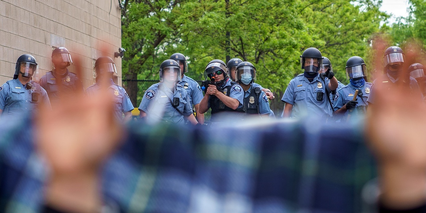 Protesters are trapped between police and other protesters who gathered in a call for justice for George Floyd following his death, outside the 3rd Police Precinct on May 27, 2020 in Minneapolis, Minnesota. - The family of an African American man killed by Minneapolis police while handcuffed in custody demanded Wednesday that the officers be charged with murder. After a night of angry protests over the death of George Floyd, with law enforcement firing tear gas and rubber bullets in the northern US city, his sister Bridgett Floyd demanded the arrest of the four white police officers involved in his death. (Photo by kerem yucel / AFP) (Photo by KEREM YUCEL/AFP via Getty Images)